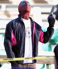 ryan reynolds wields a gun deadpool 2 jacket