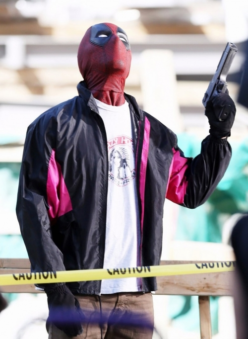 ryan reynolds wields a gun deadpool 2 jacket